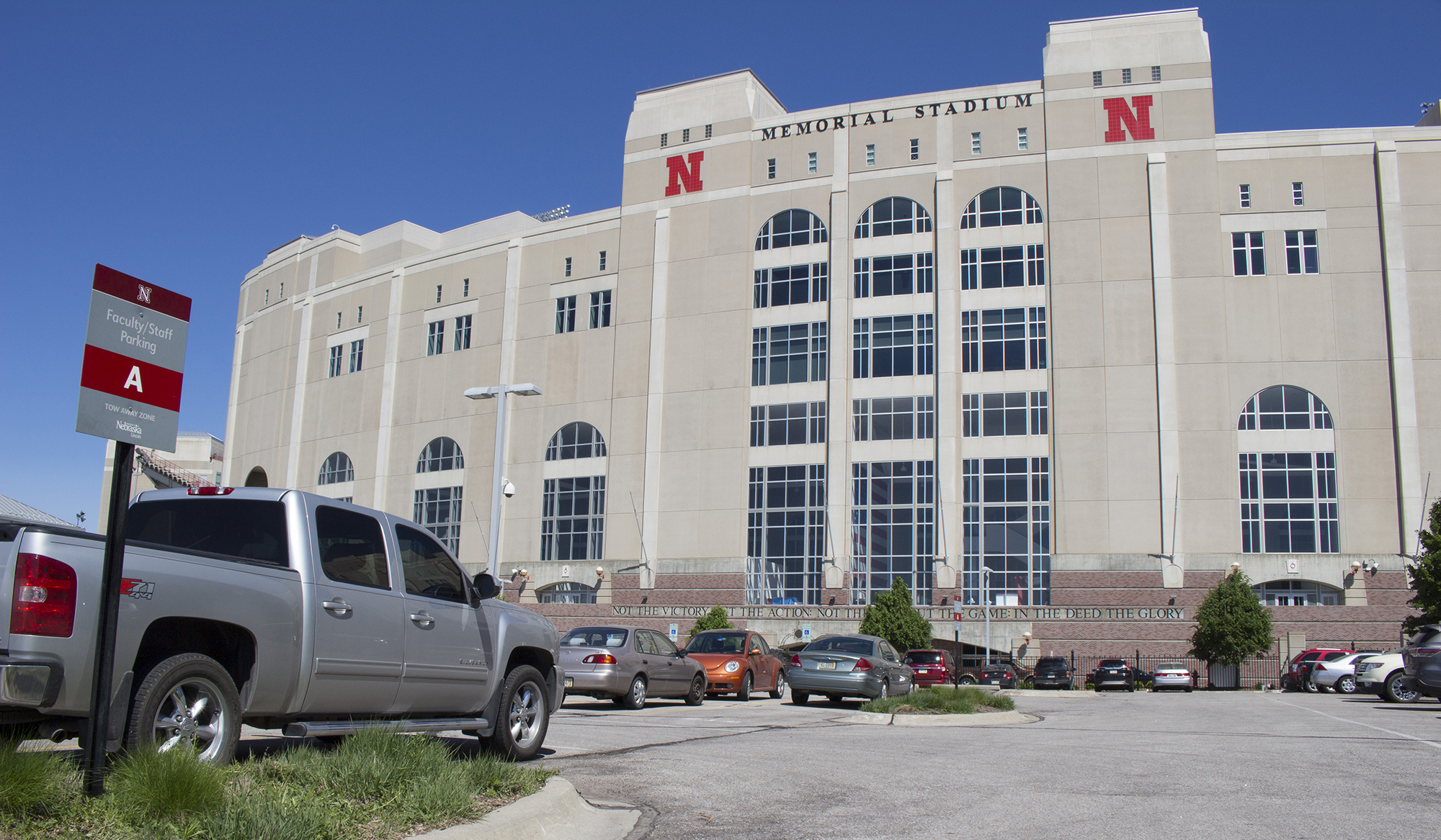 Image of vehicle parked in a designated parking lot by the Memorial Stadium